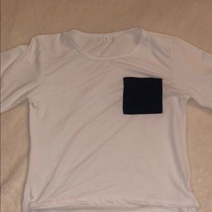 white crop top with navy blue pocket